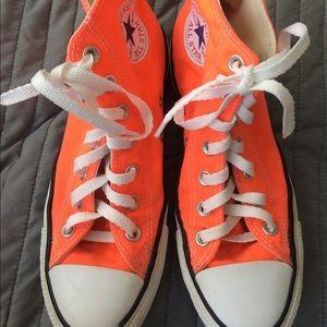 Bright coral/orange high top converse